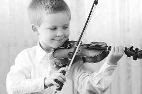 A boy playing a violin